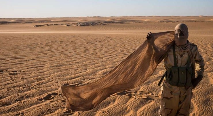 جندي من الجيش الموريتاني وسط الصحراء - وكالات